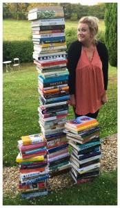 Juanita Hennessey 2016 MasterChef Finalist - standing next to her cook books